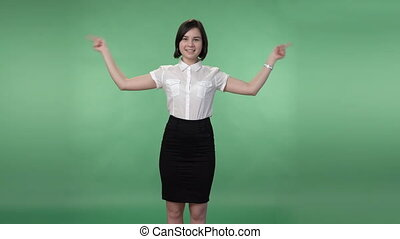 woman in business clothing showing something