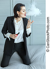 Woman in business suit Vaping