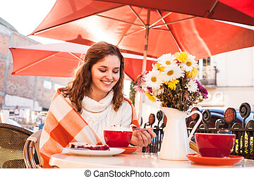 Woman in cafe outdoor