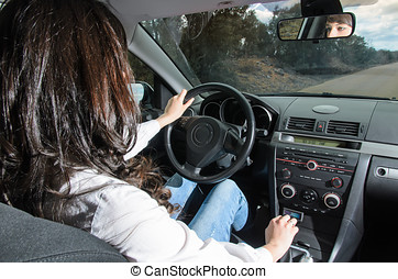 Woman in car - Woman driving car with hand in gear shift