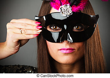 Woman in carnival mask.