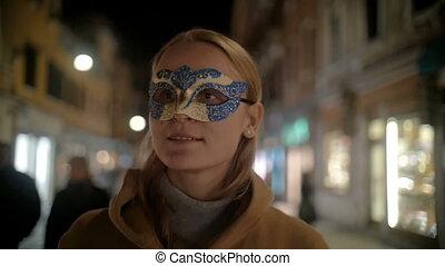 Woman in Carnival Mask Walking in Venice, Italy