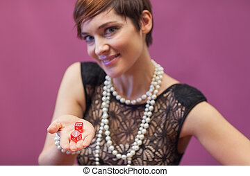 Woman in casino holding dices
