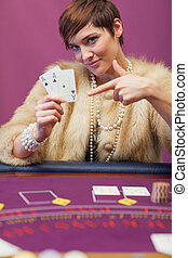 Woman in casino showing cards