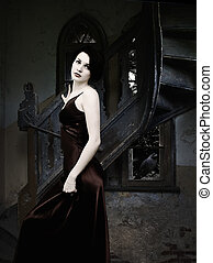 Woman in Castle - Woman and raven inside the dark castle in...