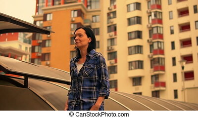 woman in casual outfit walking in a city landscape -...