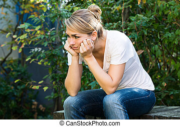Woman In Casuals Massaging Head