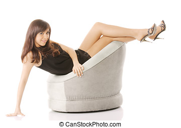 Woman in chair with legs raised