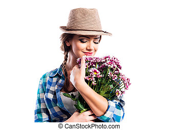 Woman in checked shirt holding bouquet of chrysanthemum ...
