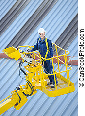 Woman in cherry picker cage