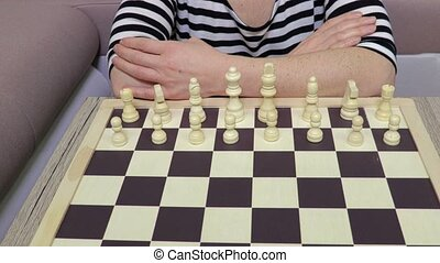 Woman in chess make a move ahead with pawn