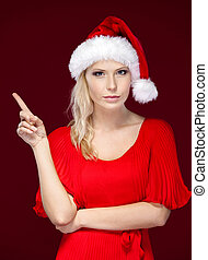 Woman in Christmas cap makes attention gesture
