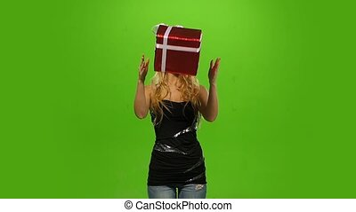 woman in Christmas cap with gift. green screen. Slow motion