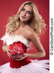 Woman in Christmas dress holding a gift