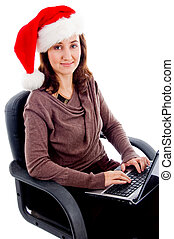 woman in christmas hat busy with laptop