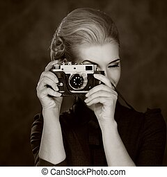 Woman in classic dress with retro camera.