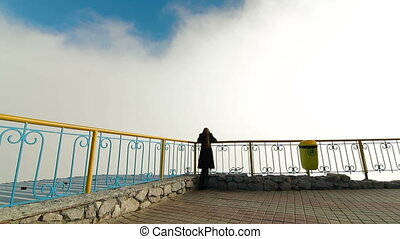 woman in  clouds on  mountain top