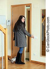 Woman in coat  leaving  home
