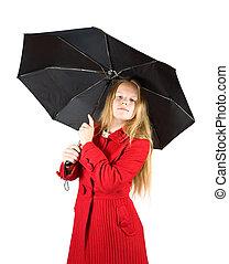 woman in coat with umbrella
