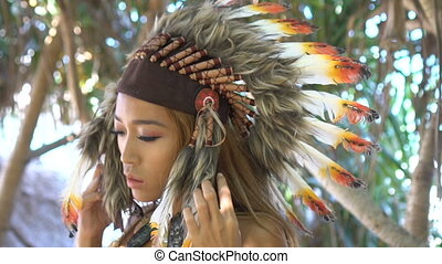 Woman in colourful indian feather hat - Native American...