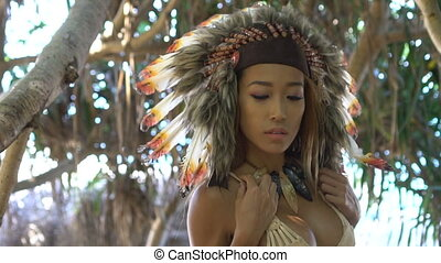 Woman in colourful indian feather hat - Sensual Native...