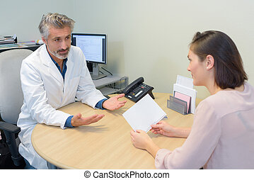 Woman in consultation with her doctor