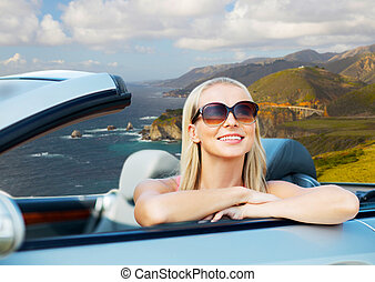 woman in convertible car on big sur coast