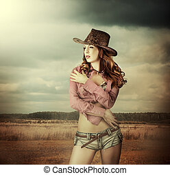 Woman in cowboy hat and sexy shorts - Young sexy Woman...