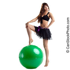 woman in dance costume posing with green ball