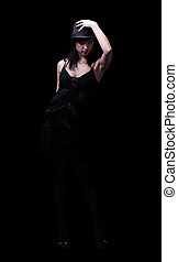 Woman in dance dress isolated on black background