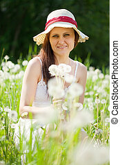 woman in dandelion plant
