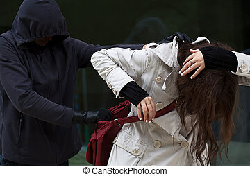 Woman in danger - Woman attacked by a bandit, who wants to...