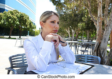 Woman in Deep Concentration - A pretty blonde business woman...