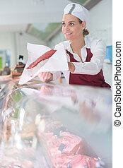 woman in delicatessen section