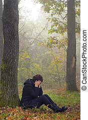 woman in depression in forest