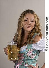 Woman in Dirndl Holding Mug of Beer Strikes a Pose