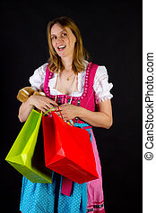 Woman in dirndl on shopping tour