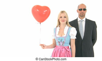 Woman in Dirndl with Bodyguard
