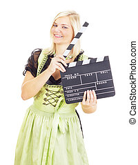 Woman in dirndl with clapperboard