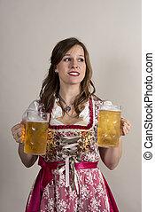 Woman in Dirndl with Huge Mugs of Beer in Each Hand