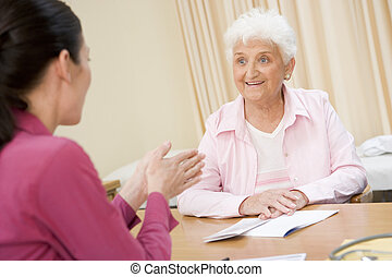 Woman in doctor\'s office smiling