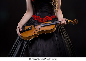 Woman in dress holding violin