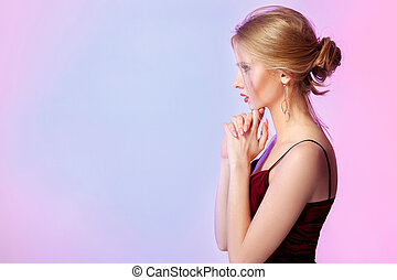 woman in dress in colorful bright lights