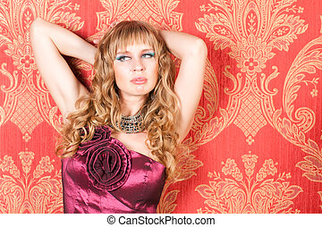 woman in dress near the wall