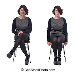 woman in dress sitting on a white background