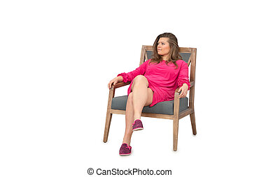 woman in dress sitting on chair