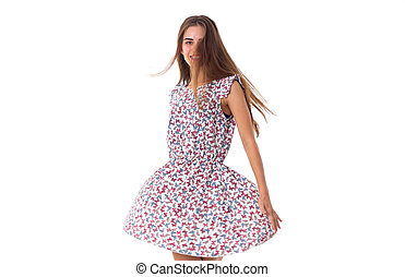 Woman in dress whirling