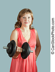 woman in dress  with barbell
