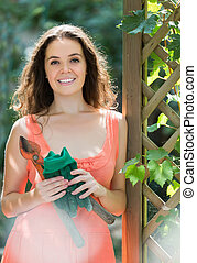 Woman in dress with pruner