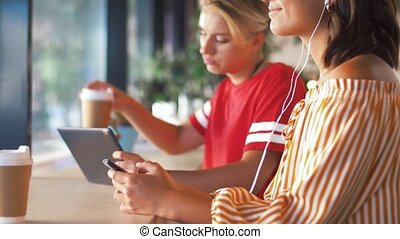 woman in earphones listening music on smartphone - ...